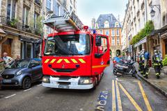 firefighters arrived at the emergency call, Paris - stock photo