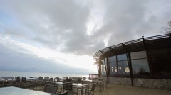 Sunset, restaurant on the beach Stock Footage