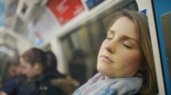Attractive young woman asleep on public transportation, in slow motion Stock Footage