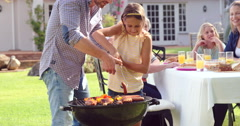 Family having a barbecue together in garden Stock Footage
