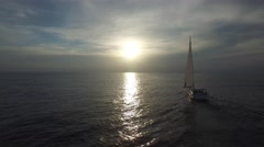 Sailing yacht in the ocean. Sun ahead. Stock Footage