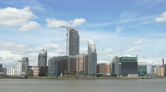 Tower crane and modern buildings on the riverside in London - stock footage