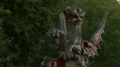 Close up of a sculpture representing a dragon holding the London flag Stock Footage