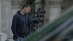Man filming with a professional camera in London - stock footage