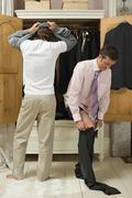 Gay couple dressing Kuvituskuvat
