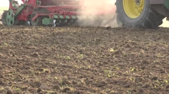 Tractor pulling seeder tool sow agriculture field soil with grain. Panorama. 4K Stock Footage
