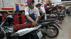 Motorbike repair center, Honda service station, garage, Saigon, Vietnam Stock Footage