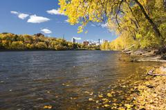 Autumn, Mississippi River, Minneapolis skyline in the distance. Minnesota - stock photo