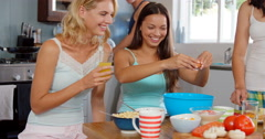 Smiling friends preparing breakfast Stock Footage