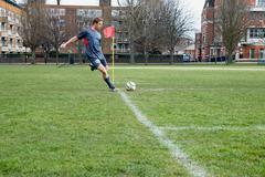 Footballer taking a corner - stock photo