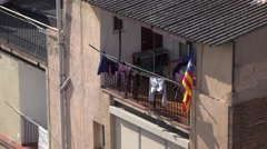 Clothes dry at sunlight, telephoto shot, recessed balcony at Barcelona Stock Footage