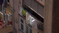 Bunch of clothes and linen dry hang out of loggia, telephoto view from above Stock Footage