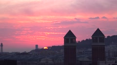 Vivid pink clouds, sunrise at Barcelona, sun disk rise up from Montjuic hill Stock Footage