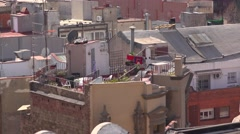Roof terrace at old narrow house, Barcelona details from above, telephoto shot. Stock Footage