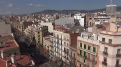 Barcelona houses and rooftops at Carrer de la Creu Coberta, pan aerial shot Stock Footage