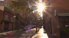 Shaded and sunny street come upwards, trucking shot, Barcelona alley Stock Footage