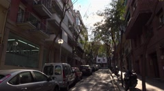 Sunny Carrer Del Centre at Barcelona, dolly camera motion, move back downward Stock Footage