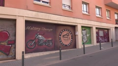 Art graffiti picture at Barcelona Racer Cafe entrance shutter door, Stock Footage