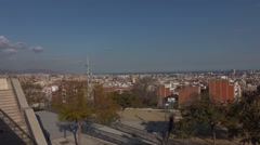 Barcelona roofs from Mas Guinardo, panning shot, sunny evening, flat profile - stock footage