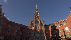 Hospital of Holy Cross and Saint Paul, main building clock tower, tilt shot Stock Footage