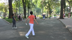 People play traditional Vietnamese football game in public park in Saigon Arkistovideo