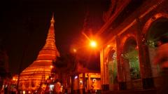 Shwedagon pagoda in Yangon of Myanmar night hyperlapse people motion Stock Footage