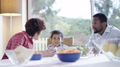 4K Family problems - parents having serious discussion at the lunch table Stock Footage