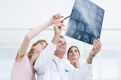 Doctors looking at mri scan Stock Photos