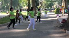 Women dancing in a public park to stay healthy and fit, in Saigon, Vietnam Stock Footage