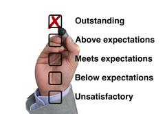 Businessman fills out performance rating - stock photo