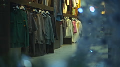 Shop-window of clothes shop whith christmas decoration. - stock footage