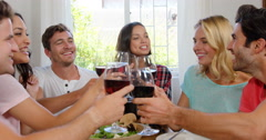 Happy friends having healthy lunch with wine Stock Footage