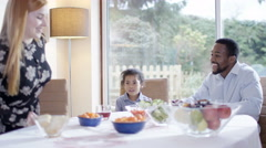 4K Happy mixed ethnicity family having lunch at home Stock Footage