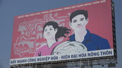 Communist Party banner displaying happy factory workers in Saigon, Vietnam Stock Footage
