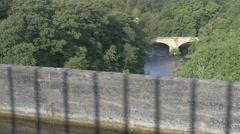 Car on Old Stone Bridge Stock Footage