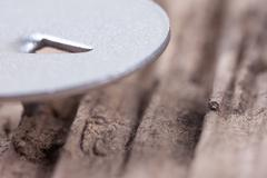 Extra macro image hat metal pushpin on old wood Stock Photos