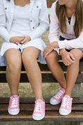 Girls in matching shoes - stock photo