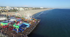 Flying past the Santa Monica Pier to the beach Stock Footage