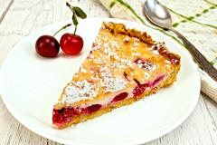 Pie cherry with sour cream on board Stock Photos