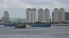 Mo Chi Minh City, apartments, cargo vessels, Saigon river, urbanization Vietnam - stock footage