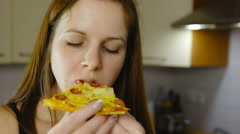 Woman bite pizza and smile portrait shot 4K Stock Footage