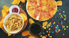 Fast food and unhealthy eating concept - close up of pizza Stock Footage