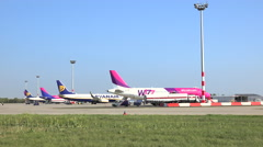 Airplanes of discount airlines parking in airport - Budapest Stock Footage
