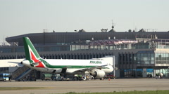 Alitalia airlines airplane parking on airport Stock Footage