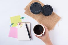 notepad and take away coffee cup - stock photo