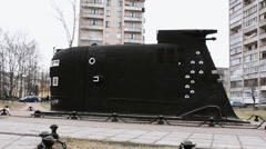 Stock Video Footage of View of black big size model of submarine. Fleet museum. Autumn day. Buildings