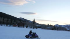 Woman snowmobiling at dusk. Stock Footage