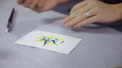 Making golden dots on painted image 4K Stock Footage