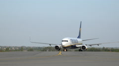 Ryanair airplane on the runway from the front Stock Footage