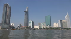 Ho Chi Minh City skyline seen from Saigon River, urban development in Vietnam Stock Footage